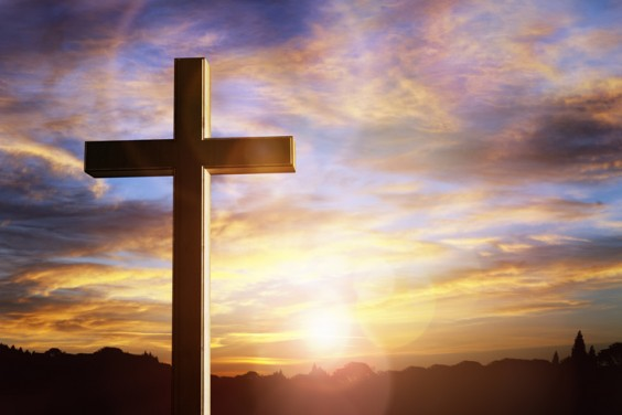 Cross at sunset crucifixion of Jesus Christ 1049887484 727x484